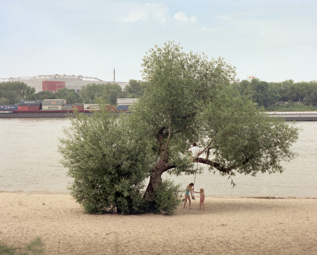 Child on swing at the Rhine meanders, Meerbusch